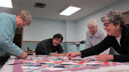 Quilters enjoy their work and fellowship at Rose City Park Presbyterian Church in Northeast Portland, Oregon.