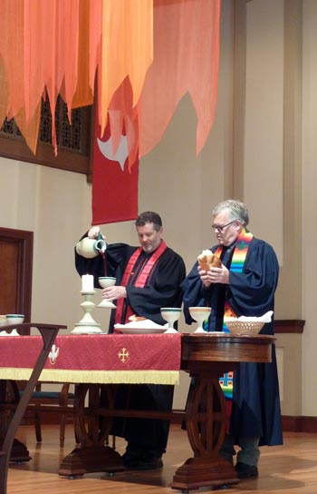 Pastors perform communion service on Pentecost at Rose City Park Presbyterian Church in Northeast Portland, Oregon.